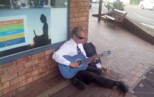 Geoff busking with his blue classical acoustic guitar in Maclean N.S.W. Australia